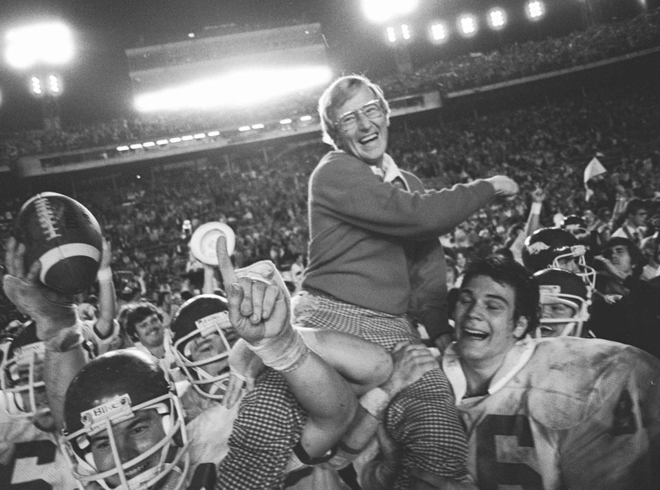 Photo - COLLEGE FOOTBALL: Arkansas coach Lou Holtz is carried by his players after defeating the University of Oklahoma (OU) at the Orange Bowl in Miami, Jan. 2, 1978. (AP Photo/Phil Sandlin) ORG XMIT: NY164