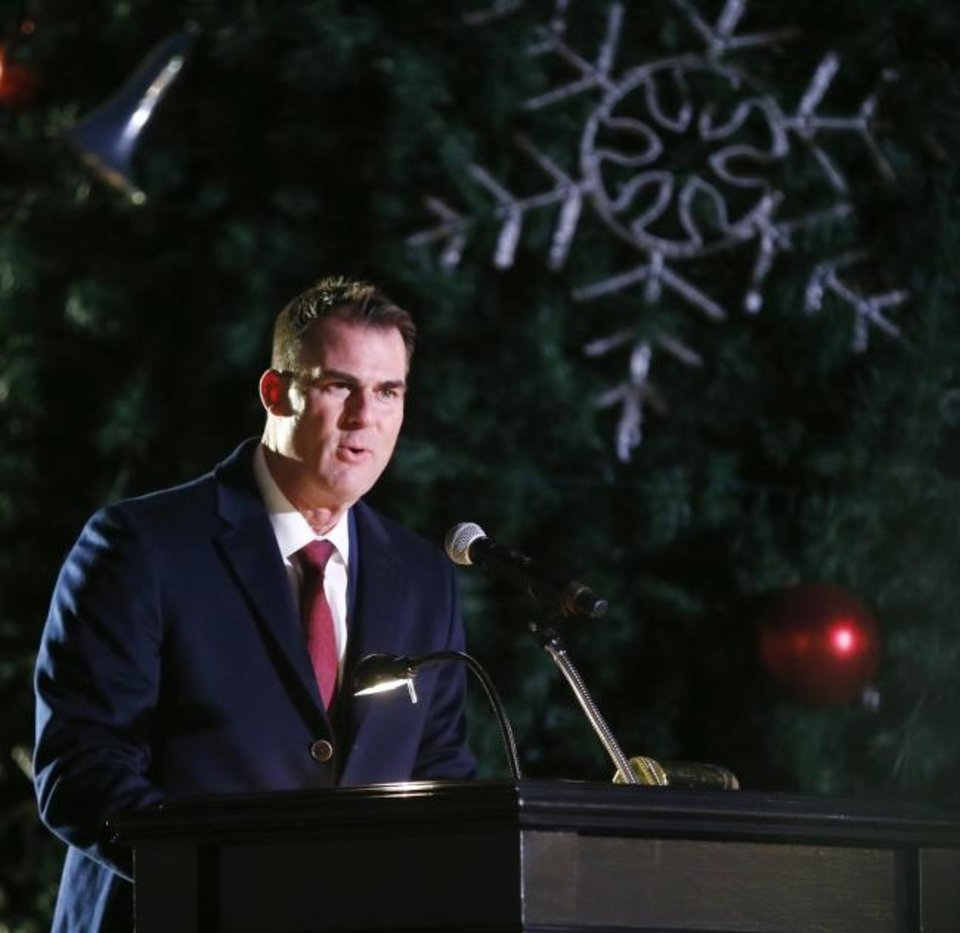 Photo -  Gov. Kevin Stitt speaks during the Governor's Christmas Tree Lighting at the Oklahoma History Center in Oklahoma City, Monday, Dec. 9, 2019. [Nate Billings/The Oklahoman]