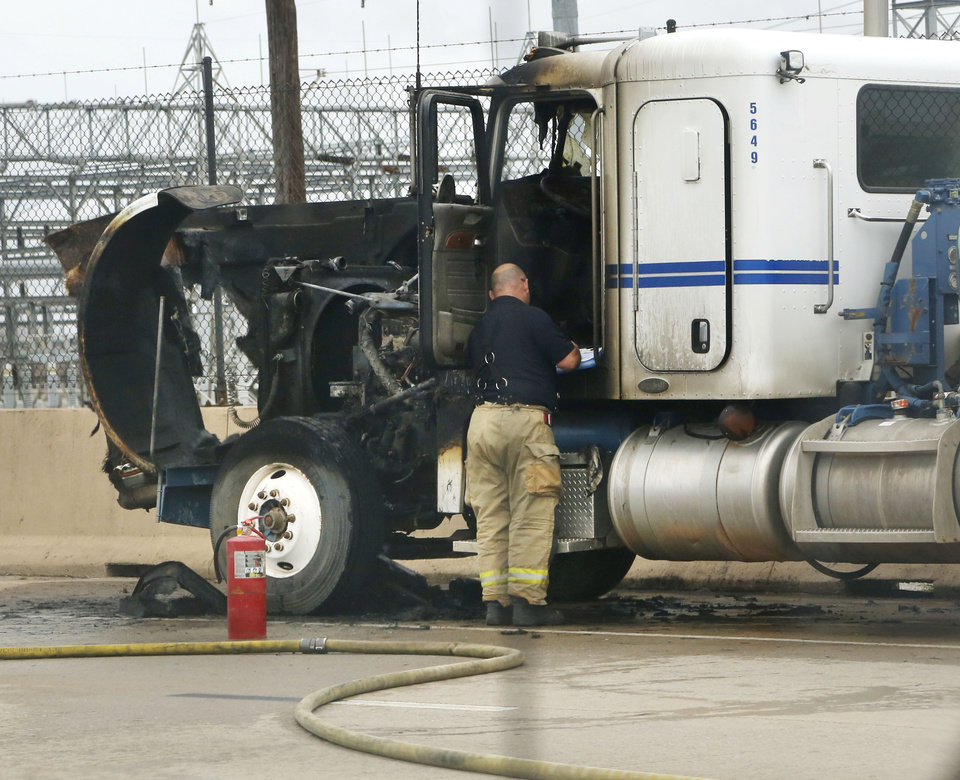 Photo - The Oklahoma Highway Patrol shuts down eastbound I-40 to a single lane at May Ave. in Oklahoma City, Okla., due to an engine fire in a semi-truck, Monday, Feb. 20, 2017.  Photo by Paul Hellstern, The Oklahoman