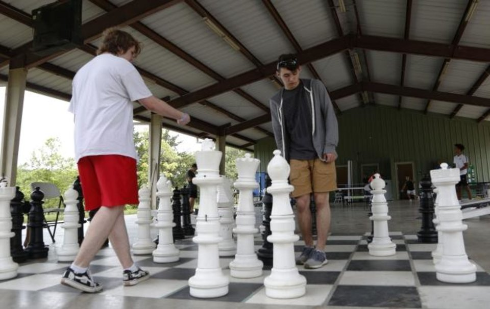 Photo -  Youths play a giant game of chess at Falls Creek.