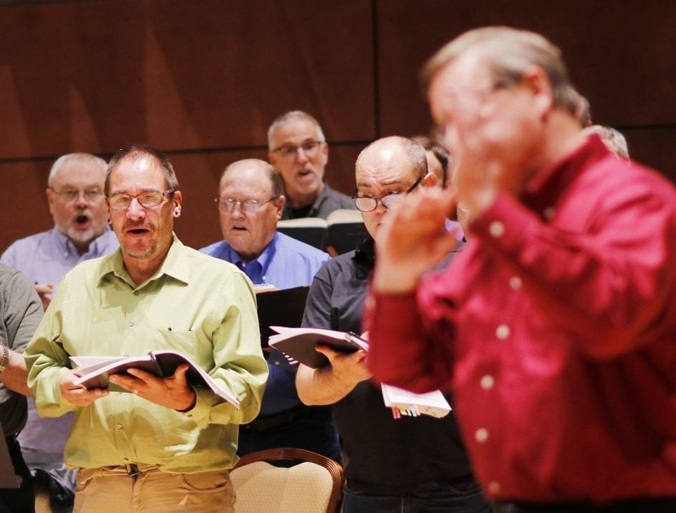 Photo -  Artistic director Randi Von Ellefson leads the Canterbury Voices' practice for the performance of Handel's