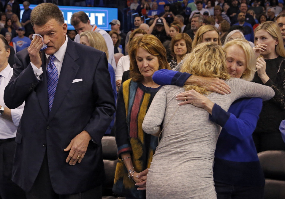 Photo - Thunder owner Clay Bennett wipes his eyes after a moment of silence for Aubrey McClendon during the NBA basketball game between the Oklahoma City Thunder and the Los Angeles Clippers at Chesapeake Energy Arena on Wednesday, March 9, 2016, in Oklahoma City, Okla. Photo by Chris Landsberger, The Oklahoman