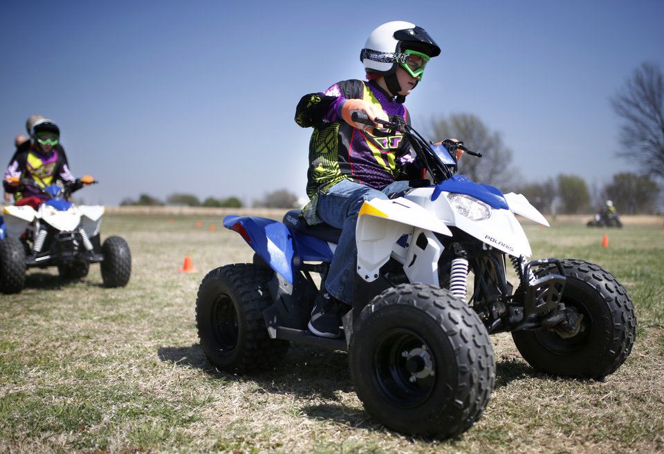 Photo -  Dawson Rudd, 13, rides during an ATV during a March 23 safety class at Sequoyah Middle School in Claremore. [Photo by Sarah Phipps, The Oklahoman]