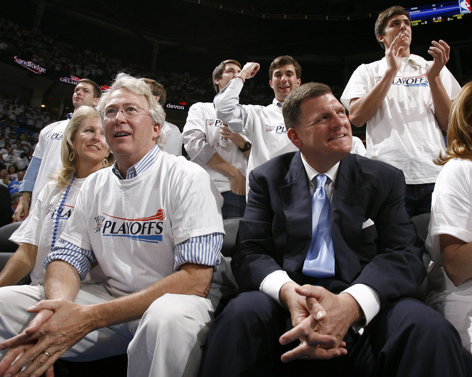 Photo -  In an April 24, 2010, file photo, Chesapeake founder Aubrey McClendon, left, and Clay Bennett watch the final seconds of a playoffs game between the Lakers and the Thunder at what was then known as the Ford Center, in Oklahoma City. The arena later was renamed Chesapeake Energy Arena. [Photo by Sarah Phipps, The Oklahoman Archives]