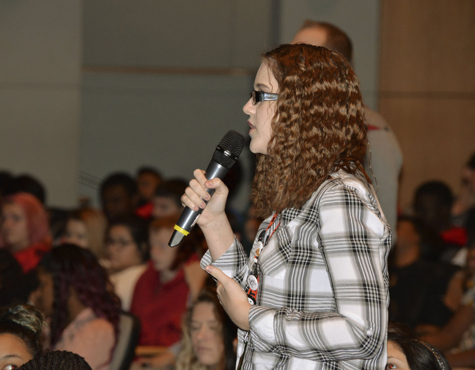 Photo -  Cailet Lively, a Carl Albert High School student, takes part in an assembly at Rose State College featuring a panel of pioneer civil rights workers. [Photo by Stacey Boyer, For The Oklahoman]