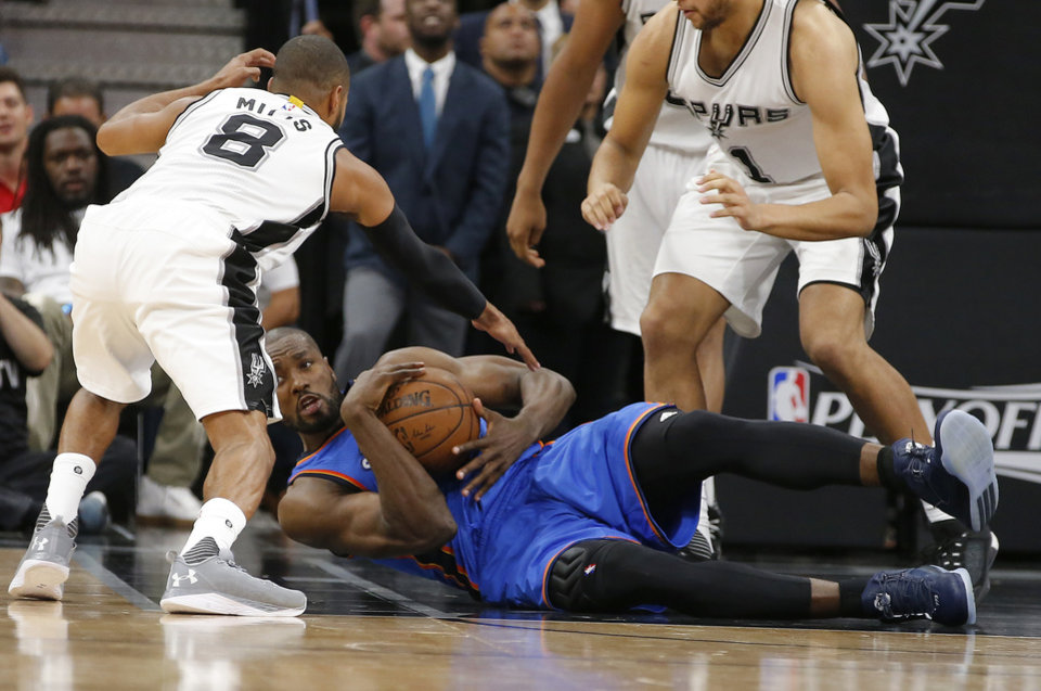 Photo - Oklahoma City's Serge Ibaka (9) dives for a loose ball during Game 5 of the second-round series between the Oklahoma City Thunder and the San Antonio Spurs in the NBA playoffs at the AT&T Center in San Antonio, Tuesday, May 10, 2016. Oklahoma City won 95-91. Photo by Bryan Terry, The Oklahoman