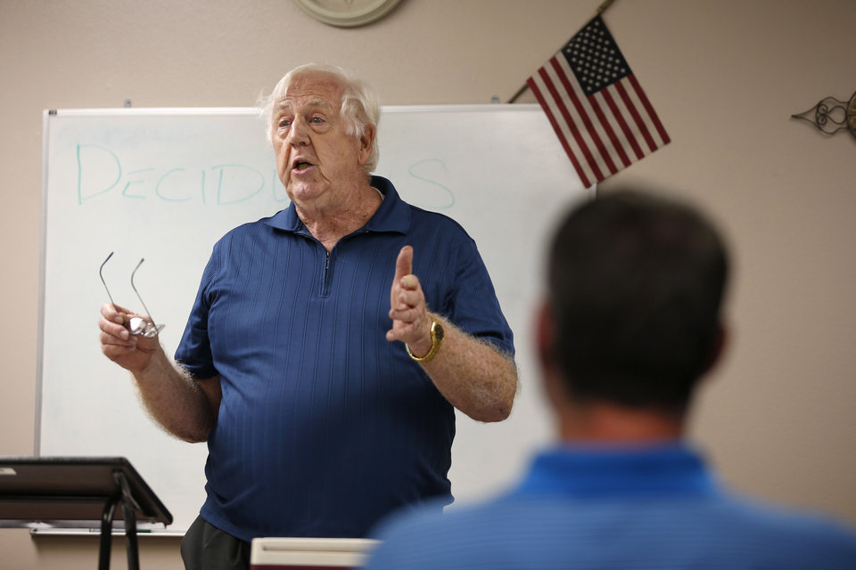 Photo -  Tom Graham speaks during a Moore Toastmasters meeting. [PHOTO BY BRYAN TERRY, THE OKLAHOMAN]