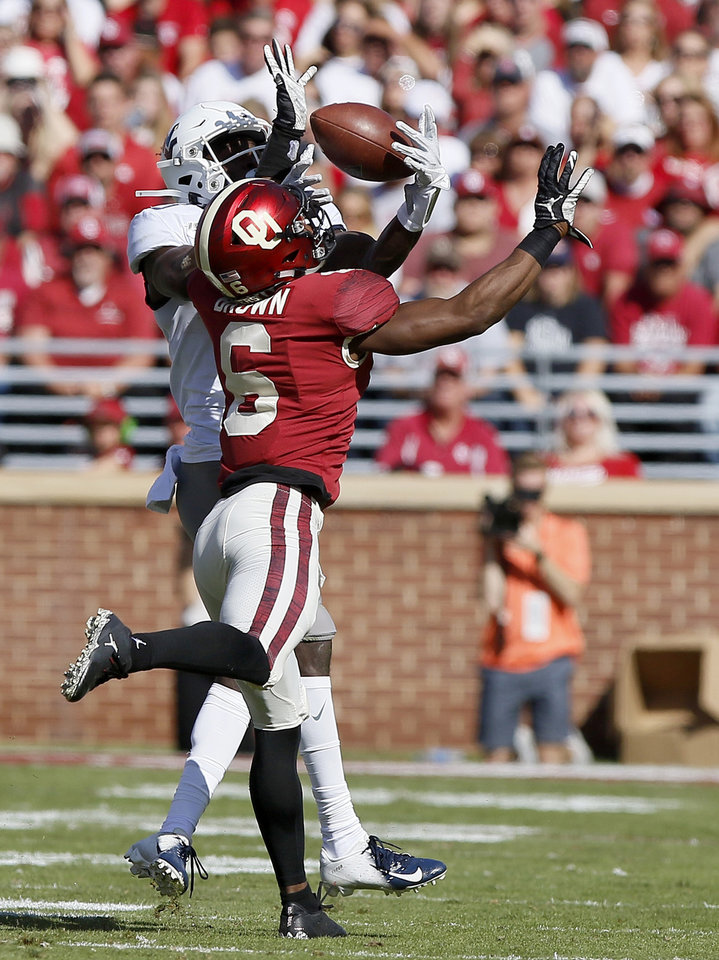 Photo - Oklahoma's Tre Brown (6) breaks up a pass intended for West Virginia's Sam James (13) during a college football game between the University of Oklahoma Sooners (OU) and the West Virginia Mountaineers at Gaylord Family-Oklahoma Memorial Stadium in Norman, Okla, Saturday, Oct. 19, 2019. Oklahoma won 52-14. [Bryan Terry/The Oklahoman]
