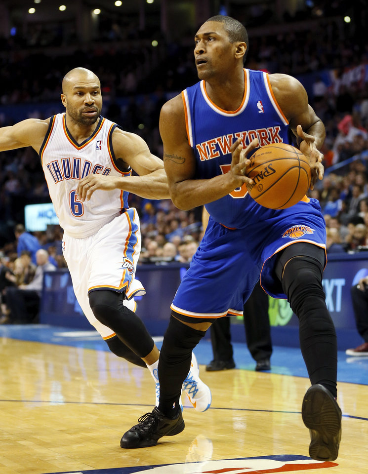 Photo - Metta World Peace (51) prepares to take a shot in front of Oklahoma City's Derek Fisher (6) during an NBA basketball game between the New York Knicks and the Oklahoma City Thunder at Chesapeake Energy Arena in Oklahoma City, Sunday, Feb. 9, 2014. Oklahoma City won, 112-100. Photo by Nate Billings, The Oklahoman