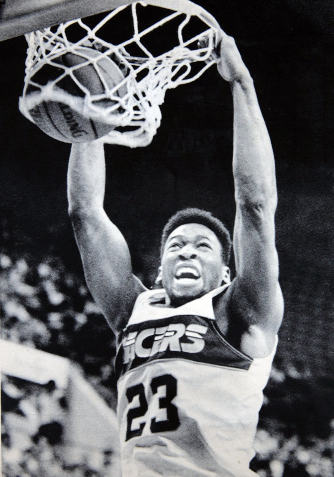 Photo - Former OU basketball player Wayman Tisdale. SLAM TIME - Former OU star Wayman Tisdale of the Indiana Pacers slams in two of his 24 points against the Milwaukee Bucks Wednesday. Tisdale led the Pacers to a 125-108 victory.  Photo taken unknown, Photo published 3/27/1987, 8/21/1988 in The Daily Oklahoman. ORG XMIT: KOD