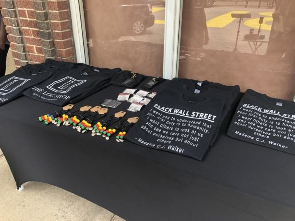 Photo -  Tables were set up throughout the Greenwood District on Saturday selling Black Lives Matter merchandise. [Kayla Branch/The Oklahoman]