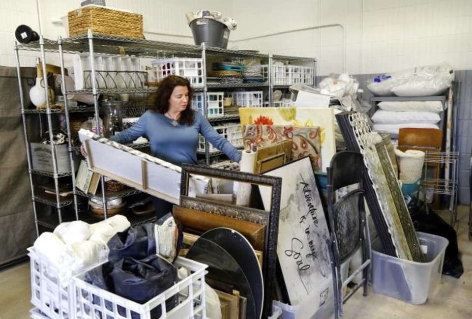 Photo -  Amie Lynn Wilson keeps a warehouse of house decor to use when staging homes for sale. [Jim Beckel/The Oklahoman]
