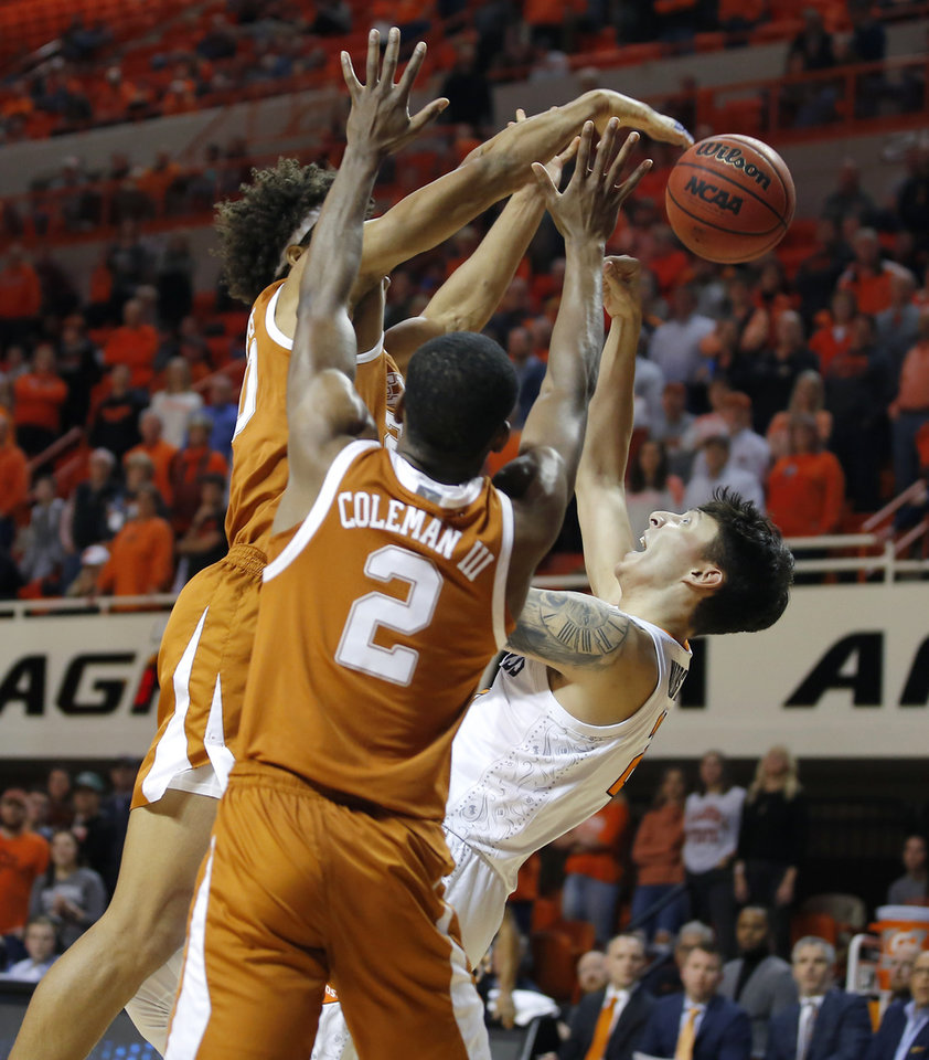 Photo - Texas' Jericho Sims (20) blocks the shot of Oklahoma State's Lindy Waters III (21) during an NCAA basketball game between the Oklahoma State University Cowboys (OSU) and the Texas Longhorns at Gallagher-Iba Arena in Stillwater, Okla., Wednesday, Jan. 15, 2020. Oklahoma State lost 76-64. [Bryan Terry/The Oklahoman]