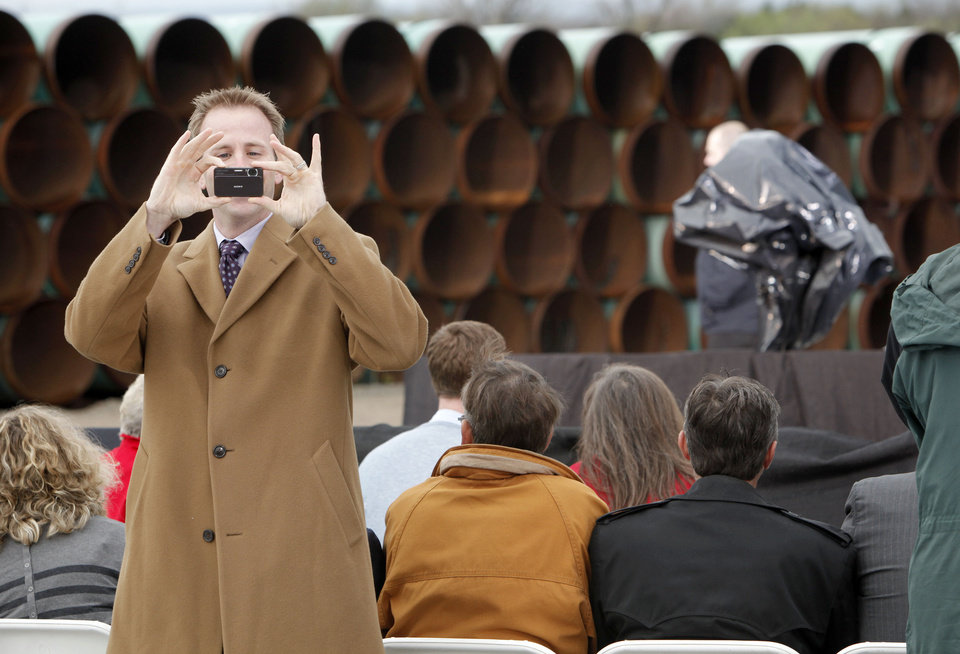 Photo - State Rep. Cory Williams of Stillwater takes a photo before the arrival of President Barack Obama at the TransCanada Pipe Yard near Cushing, Okla., Thursday, March 22, 2012. Photo by Nate Billings, The Oklahoman