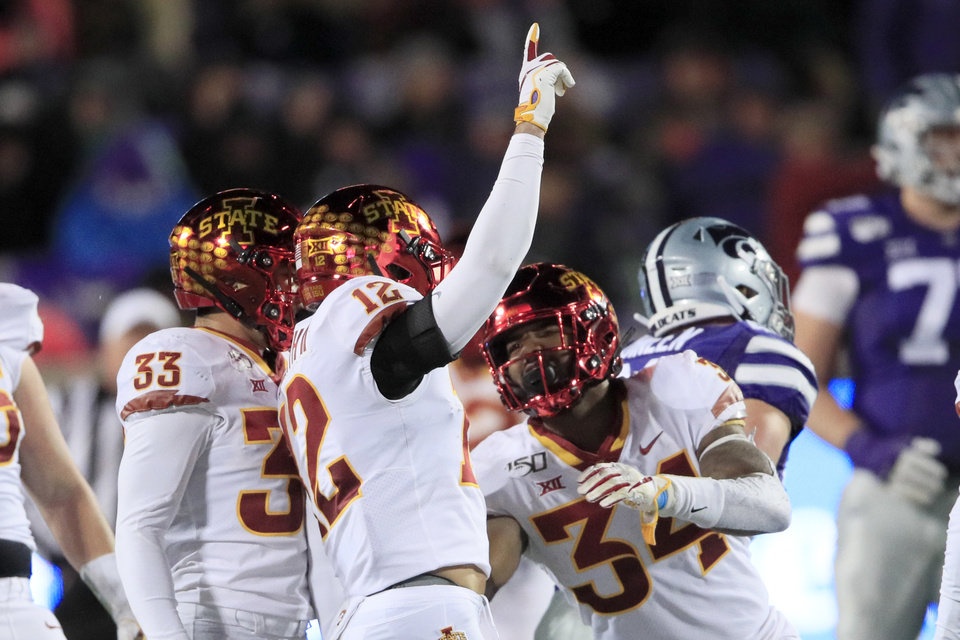 Photo - Iowa State defensive back Greg Eisworth (12) celebrates his interception with teammate O'Rien Vance (34) during the second half of an NCAA college football game against Kansas State in Manhattan, Kan., Saturday, Nov. 30, 2019. (AP Photo/Orlin Wagner)