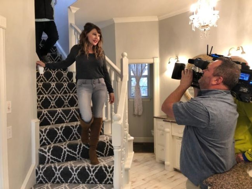 Photo -  Denise Schroder is recorded walking down stairs for an episode of