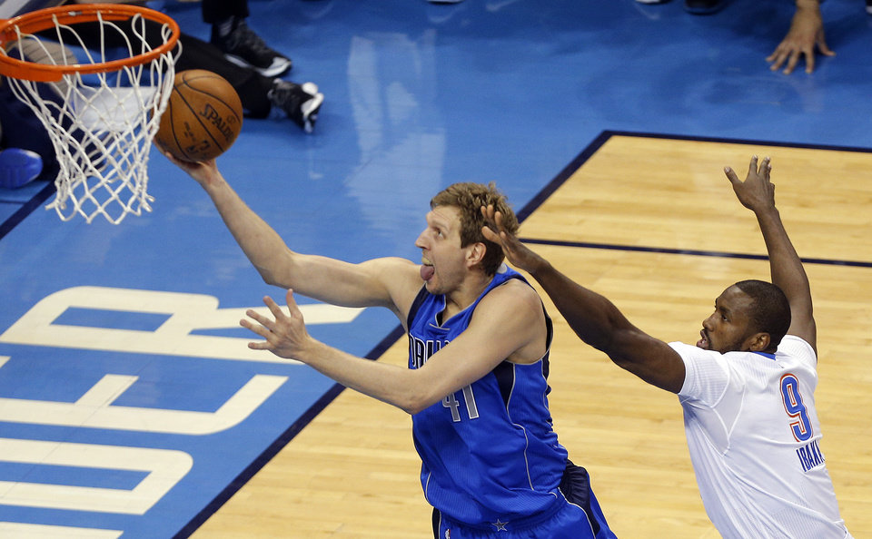 Photo - Dallas' Dirk Nowitzki (41) shoots as Oklahoma City's Serge Ibaka (9) defends during Game 2 in the first round of the NBA playoffs between the Oklahoma City Thunder and the Dallas Mavericks at Chesapeake Energy Arena in Oklahoma City, Monday, April 18, 2016. Photo by Sarah Phipps, The Oklahoman