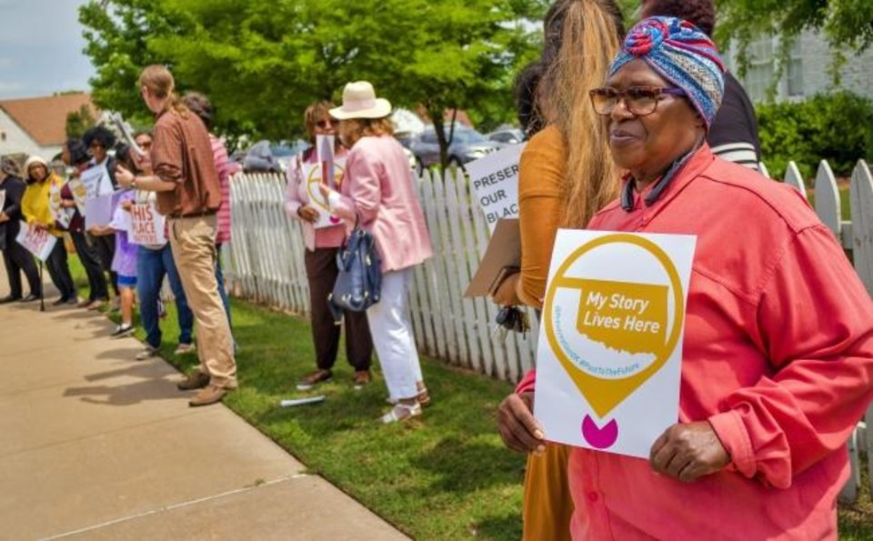 Photo -  Vera Ford on Monday carries a sign as part of the rally for the building that was home to the Oklahoma Federation of Colored Women´s Clubs for nearly 50 years as they fought during a time of segregation. [CHRIS LANDSBERGER/THE OKLAHOMAN]