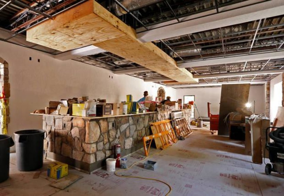 Photo -  Work nears completion at Othello's Italian Restaurant in Norman. The restaurant was destroyed in a fire last year. [Photo by Steve Sisney, The Oklahoman]