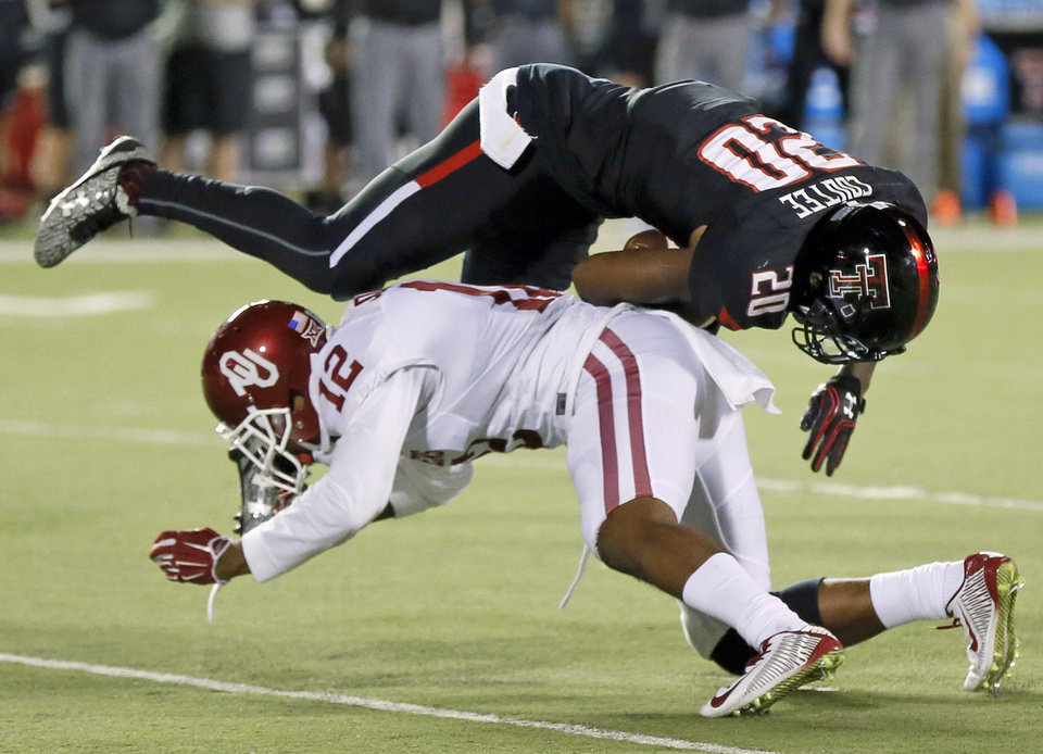 Photo - Oklahoma's Will Johnson (12) trips up Texas Tech's Keke Coutee (20) during a college football game between the University of Oklahoma Sooners (OU) and Texas Tech Red Raiders at Jones AT&T Stadium in Lubbock, Texas, Saturday, Oct. 22, 2016. OU won 66-59. Photo by Nate Billings, The Oklahoman