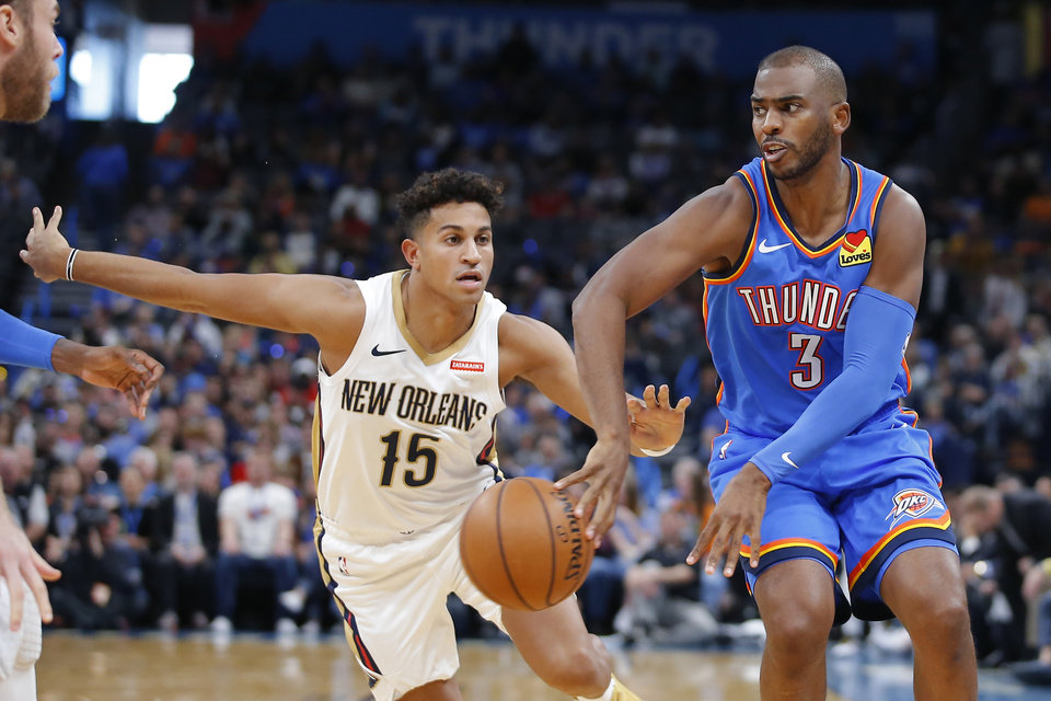 Photo - Oklahoma City's Chris Paul (3) passes the ball as New Orleans' Frank Jackson (15) defends during an NBA basketball game between the Oklahoma City Thunder and the New Orleans Pelicans at Chesapeake Energy Arena in Oklahoma City, Saturday, Nov. 2, 2019. Oklahoma City won 115-104. [Bryan Terry/The Oklahoman]