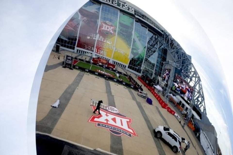 Photo -  Big 12 Championship Game preparations are reflected in a mirror. The Big 12's reflection in college football is much better these days. [Bryan Terry/The Oklahoman]