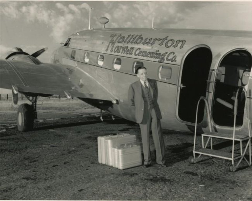 Photo -  Erle P. Halliburton stands next to a corporate aircraft with luggage he patented. [PROVIDED BY THE STEPHENS COUNTY HISTORICAL SOCIETY]
