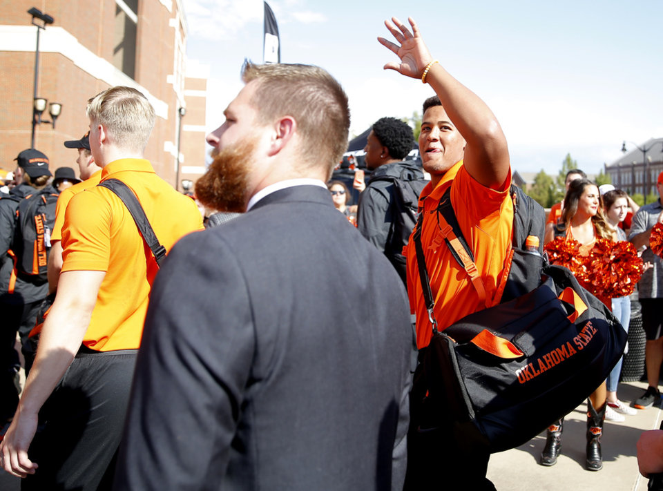 Photo - Oklahoma State's Trace Ford (94) waves to the crowd during the walk before the college football game between the Oklahoma State Cowboys and the Kansas State Wildcats at Boone Pickens Stadium in Stillwater, Okla., Saturday, Sept. 28, 2019. [Sarah Phipps/The Oklahoman]
