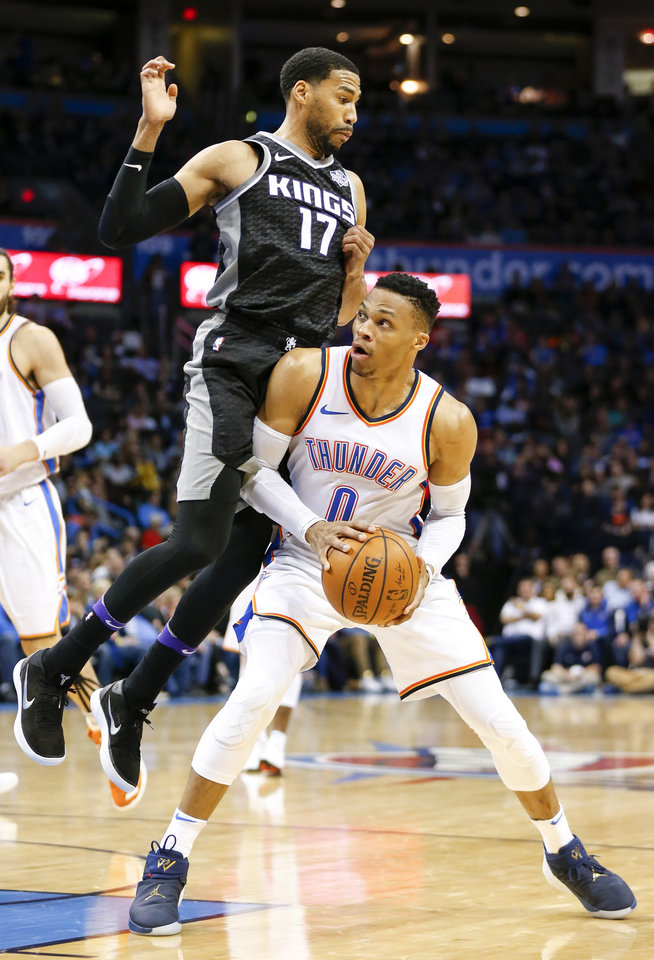 online store 8bd02 a3ec2 Oklahoma City s Russell Westbrook (0) looks to shoot as Sacramento s  Garrett Temple (17) defends during an NBA basketball game between the Oklahoma  City ...