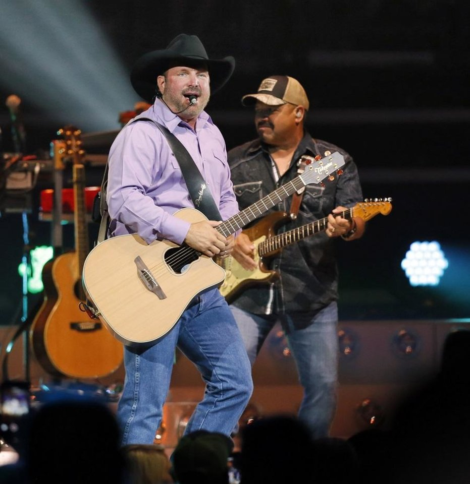 Photo - Garth Brooks performs during his 7 p.m. show at the Chesapeake Energy Arena in Oklahoma City, Friday, July 14, 2017. [Nate Billings/The Oklahoman Archives]