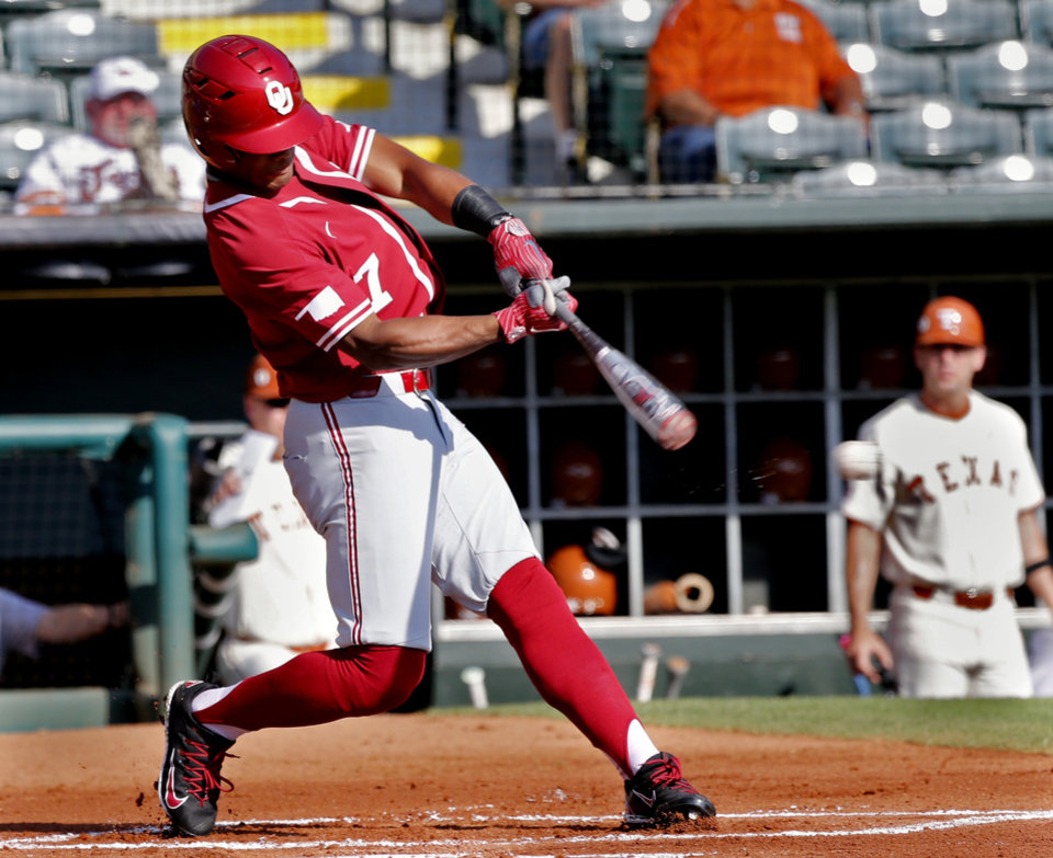 Photo - Oklahoma outfielder Kyler Murray hits an RBI single in the first inning as the University of Oklahoma Sooners (OU) play the University of Texas Longhorns (UT) in the Big 12 Baseball Championship at the Chickasaw Bricktown Ballpark in Oklahoma City, on Thursday, May 24, 2018 in Oklahoma City, Okla.  Photo by Steve Sisney, The Oklahoman