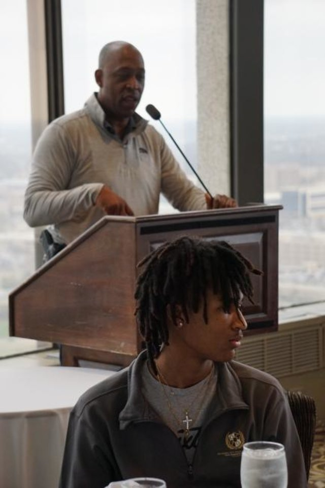 Photo -  Lashawn Webb, a member of the Oklahoma City Police Department's Youth Leadership Academy listens to Lt. Wayland Cubit talk at downtown Oklahoma City's Petroleum Club. [Josh Wallace/The Oklahoman]