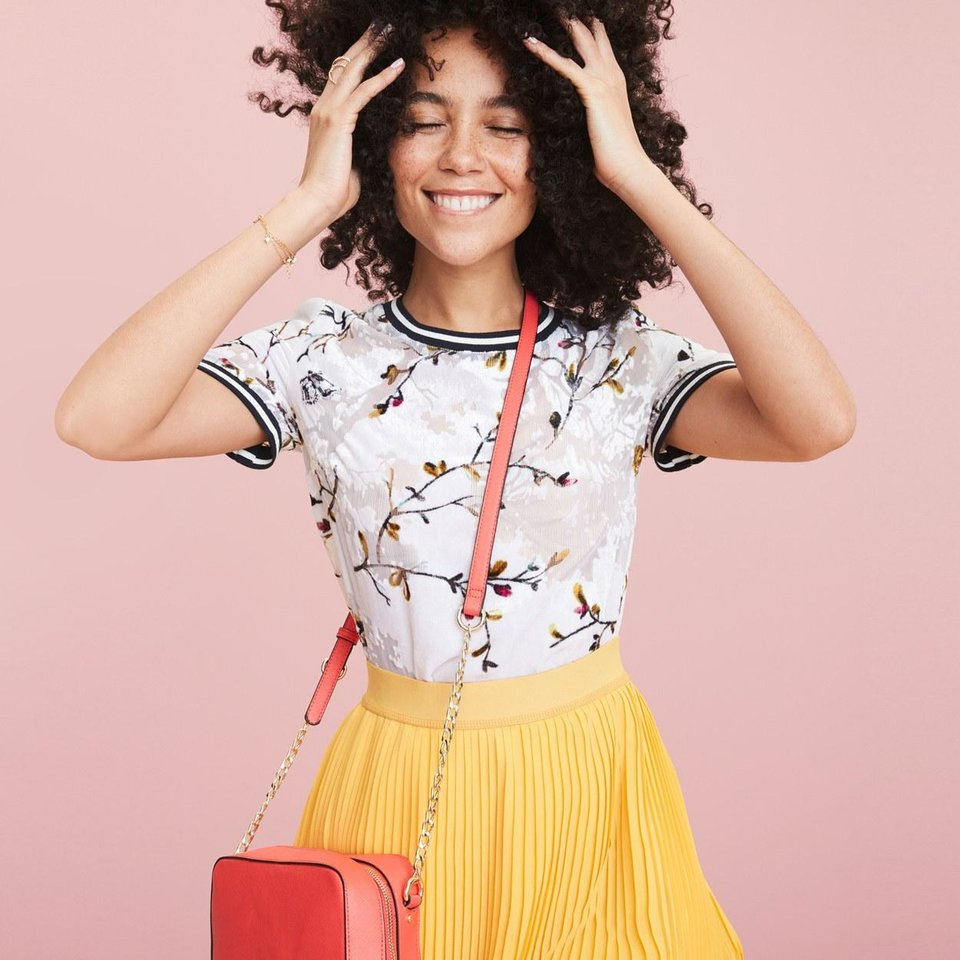 Photo - Printed top and pleated skirt. [PHOTO PROVIDED]
