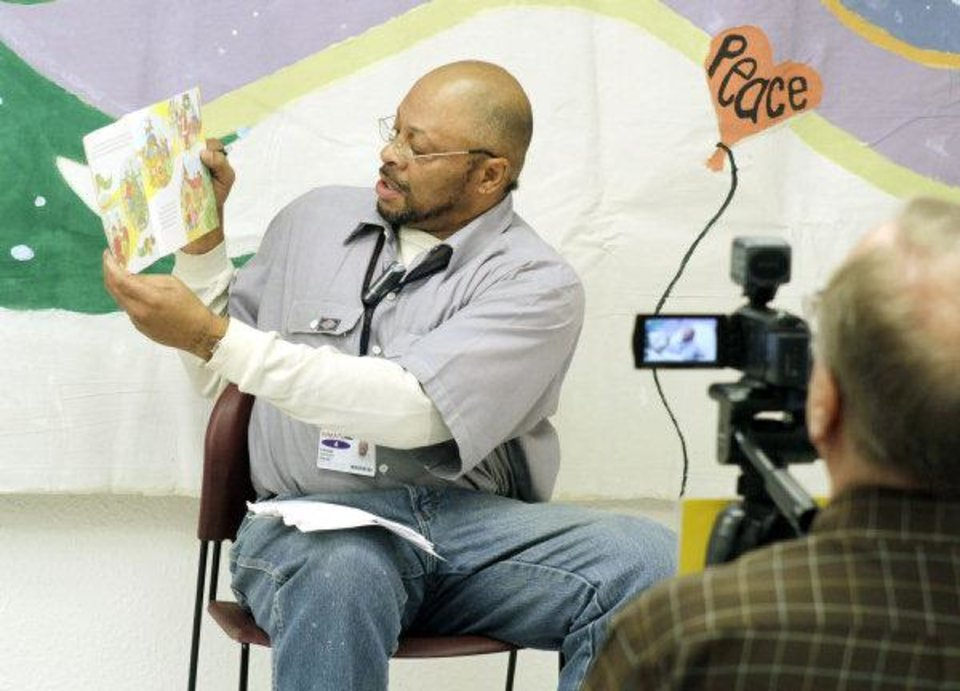 Photo - Gregory Fagan is videotaped as he reads a book for his family as part of the Oklahoma Messages Project. He is at Clara Waters Community Corrections Center in Oklahoma City. PHOTOS BY PAUL HELLSTERN, THE OKLAHOMAN