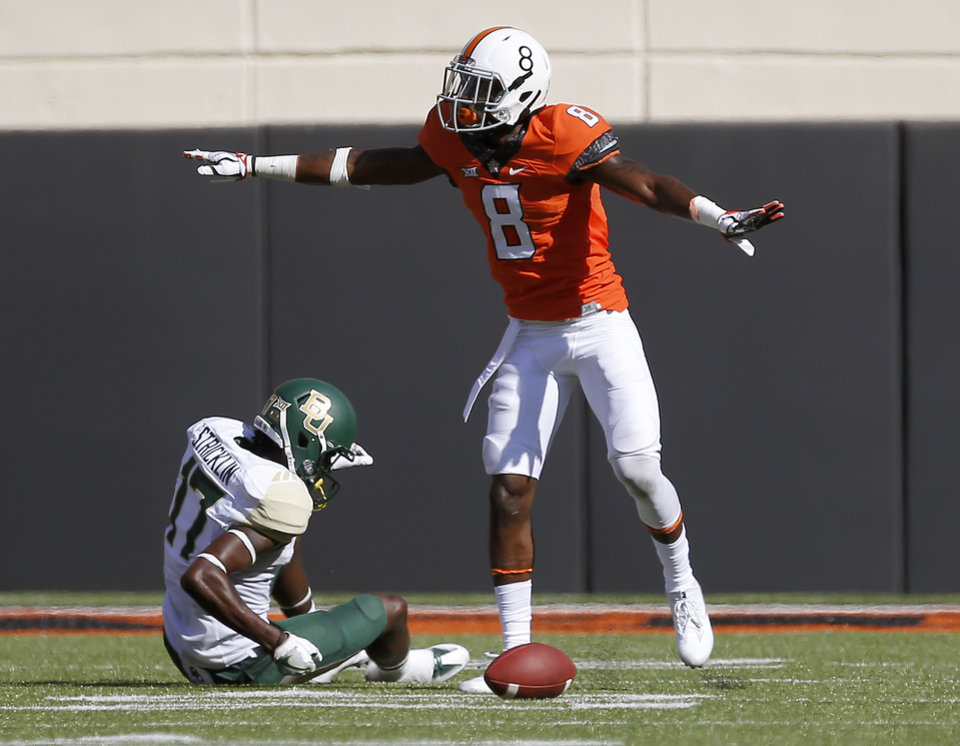 Photo - Oklahoma State's Rodarius Williams (8) celebrates over Baylor's Pooh Stricklin (17) after breaking up a pass during a college football game between the Oklahoma State University Cowboys (OSU) and the Baylor Bears at Boone Pickens Stadium in Stillwater, Okla., Saturday, Oct. 14, 2017. Oklahoma State won 59-16.  Photo by Bryan Terry, The Oklahoman