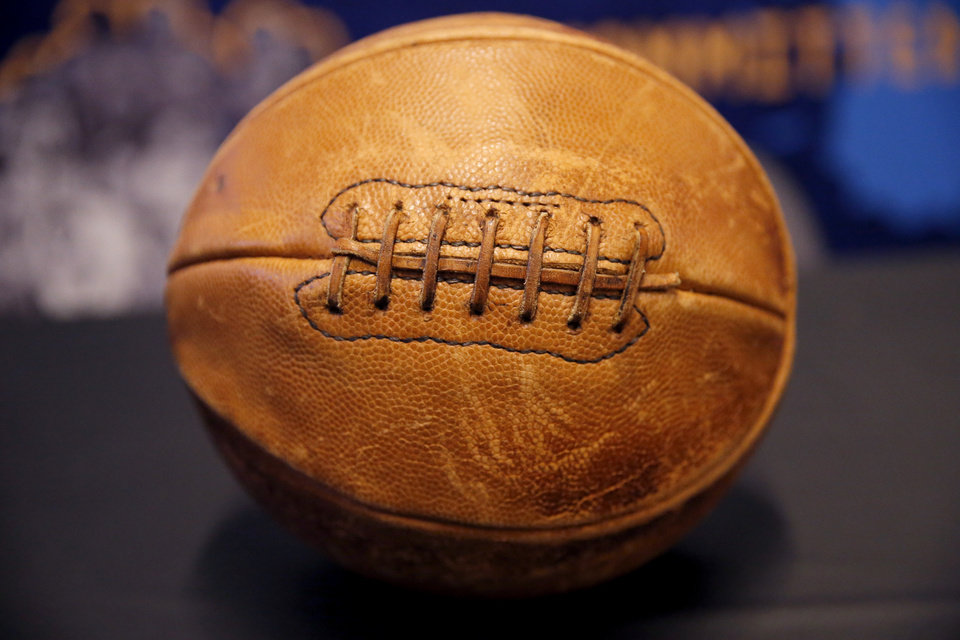 Photo - An hundred year old basketball is pictured a booth with the Black Fives Foundation before the NBA game between the Oklahoma City Thunder and the Utah Jazz at the Chesapeake Energy Arena, Friday, Feb. 22, 2019. Photo by Sarah Phipps, The Oklahoman