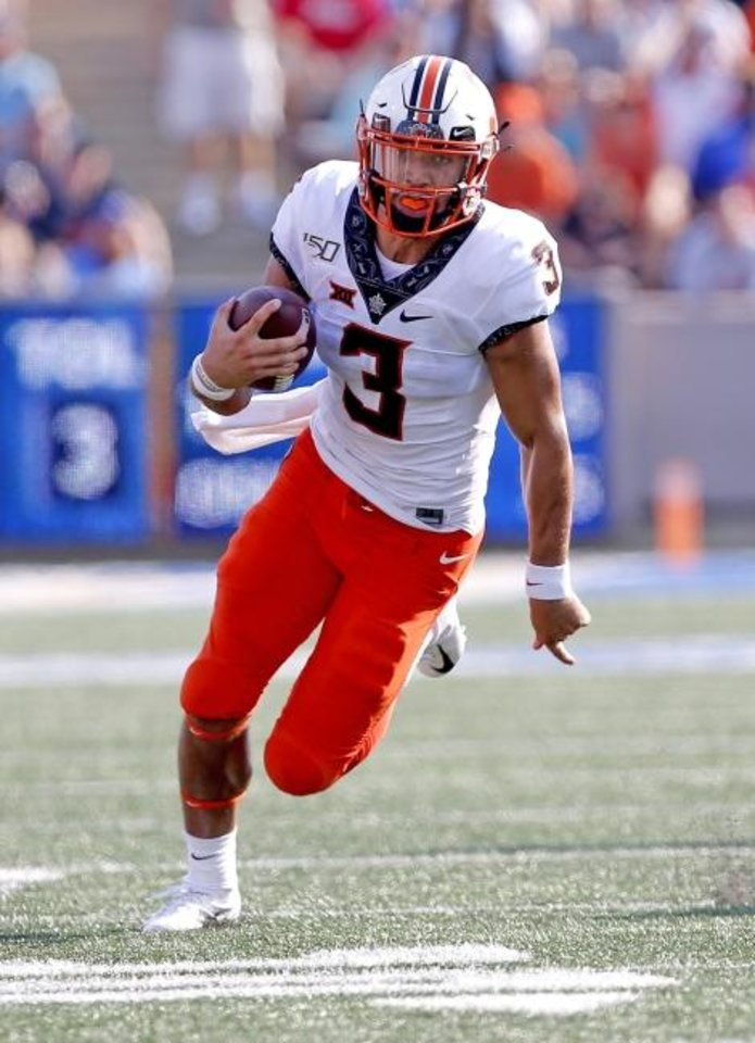 Photo -  Oklahoma State quarterback Spencer Sanders has rushed for 219 yards on 34 carries this season. He's looking to boost those numbers on Saturday against Texas in Austin.  Game time is 6:30 p.m.  [Sarah Phipps/The Oklahoman]
