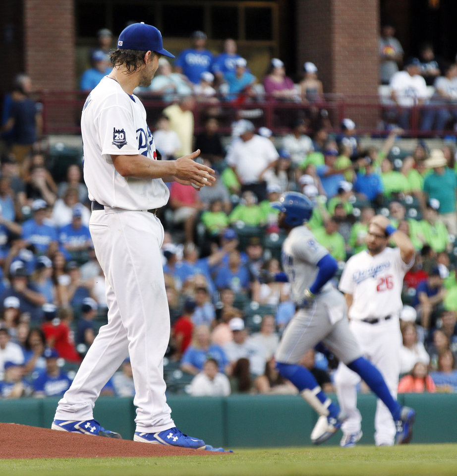 Photo - Clayton Kershaw watches Omaha's Jorge Soler (17) run the bases after hitting a home run in the second inning during a Triple-A baseball game between the Oklahoma City Dodgers and the Omaha Storm Chasers at the Chickasaw Bricktown Ballpark in Oklahoma City, Saturday, Aug. 26, 2017. Kershaw, a pitcher with Los Angeles, was on a rehab assignment in Oklahoma City. Photo by Nate Billings, The Oklahoman