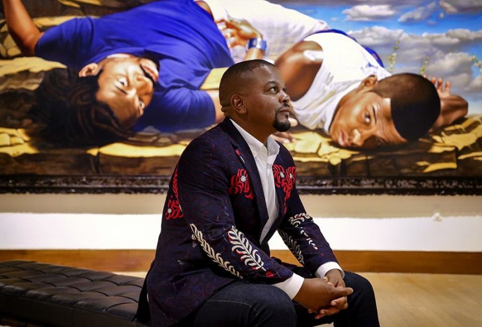 Photo - Artist Kehinde Wiley poses for a photo before the opening of his traveling exhibit