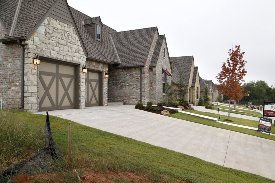 Fabulous New houses are shown in Edmond us Birnam Woods addition southwest of Bryant Avenue and Coltrane
