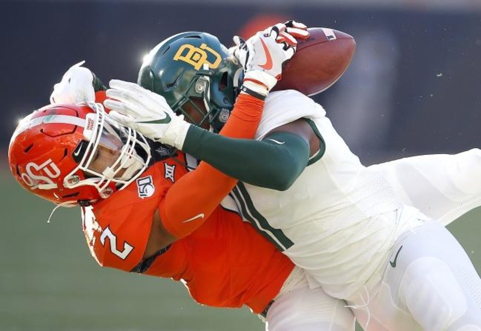 Photo -  Oklahoma State's Tylan Wallace (2) can not hang on the the ball as Baylor's Jameson Houston (11) defends in the third quarter during the college football game between Oklahoma State University and Baylor at Boone Pickens Stadium in Stillwater, Okla., Saturday, Oct. 19, 2019. Baylor won 45-27. [Sarah Phipps/The Oklahoman]