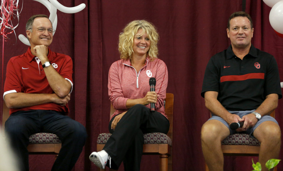 Photo - Lon Kruger, Sherri Coale and Bob Stoops sit together at the 2016 OU Caravan in Oklahoma City last August. (Photo by Bryan Terry)