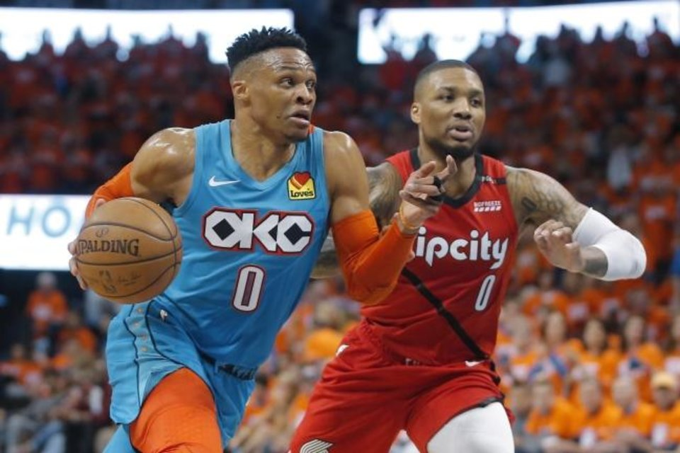Photo -  Oklahoma City's Russell Westbrook (0) goes past Damian Lillard (0) during Game 3 in the first round of the NBA playoffs Friday. [Bryan Terry/The Oklahoman]
