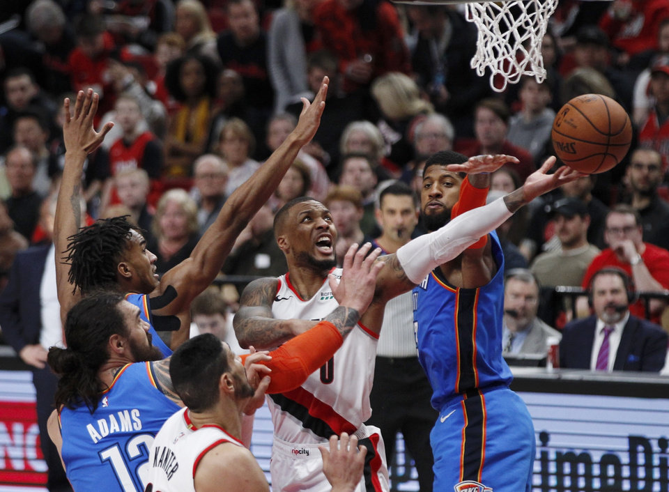 Photo - Portland Trail Blazers guard Damian Lillard (0) scores against the Oklahoma City Thunder during the second half of Game 1 of a first-round NBA basketball playoff series in Portland, Ore., Sunday, April 14, 2019. (AP Photo/Steve Dipaola)
