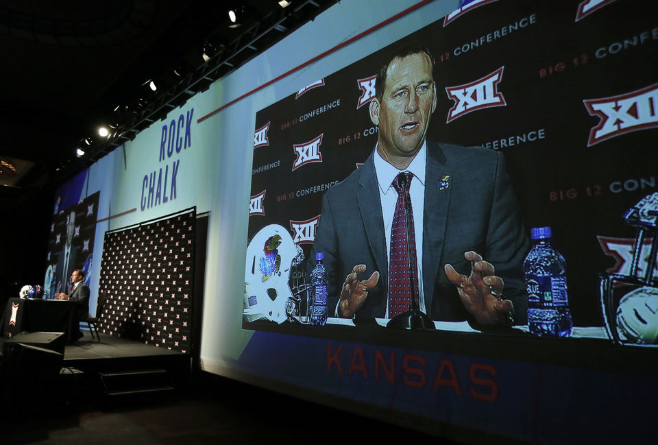 Photo - Kansas head football coach David Beaty addresses attendees at the NCAA college Big 12 Conference Football Media Days Monday, July 20, 2015, in Dallas. (AP Photo/Tony Gutierrez)