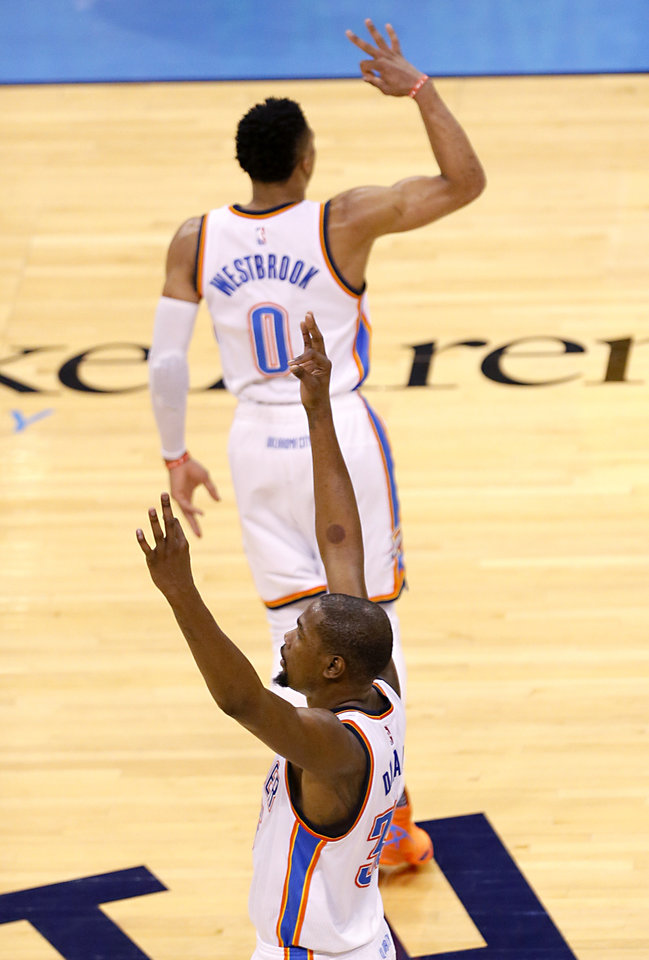 Photo - Oklahoma City's Kevin Durant (35) and Russell Westbrook (0) celebrate a Westbrook 3-point basket during Game 3 of the Western Conference finals in the NBA playoffs between the Oklahoma City Thunder and the Golden State Warriors at Chesapeake Energy Arena in Oklahoma City, Sunday, May 22, 2016. Photo by Sarah Phipps, The Oklahoman