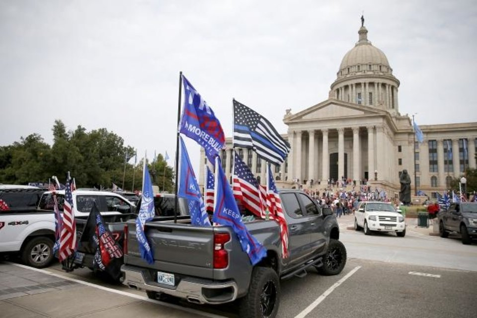 Photo - A truck decorated to show support for President Donald Trump drives in a parking lot at the state Capitol during a MAGA DRAG the Interstate event in Oklahoma City, Saturday, Oct. 3, 2020. The Facebook group #Drivefor45 Oklahoma organized the event in which President Donald Trump supporters drove 40 miles on the interstate system around Oklahoma City. [Bryan Terry/The Oklahoman]