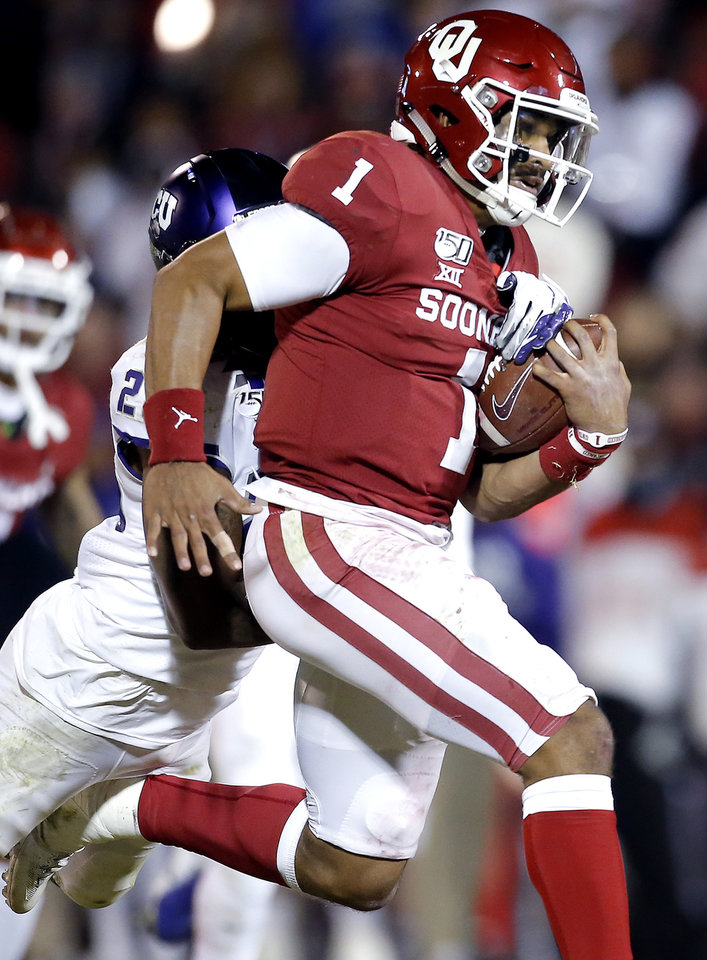 Photo - TCU's Nook Bradford (28) forces Oklahoma's Jalen Hurts (1) to fumble the ball in the fourth quarter during an NCAA football game between the University of Oklahoma Sooners (OU) and the TCU Horned Frogs at Gaylord Family-Oklahoma Memorial Stadium in Norman, Okla., Saturday, Nov. 23, 2019. OU won 28-24. [Sarah Phipps/The Oklahoman]