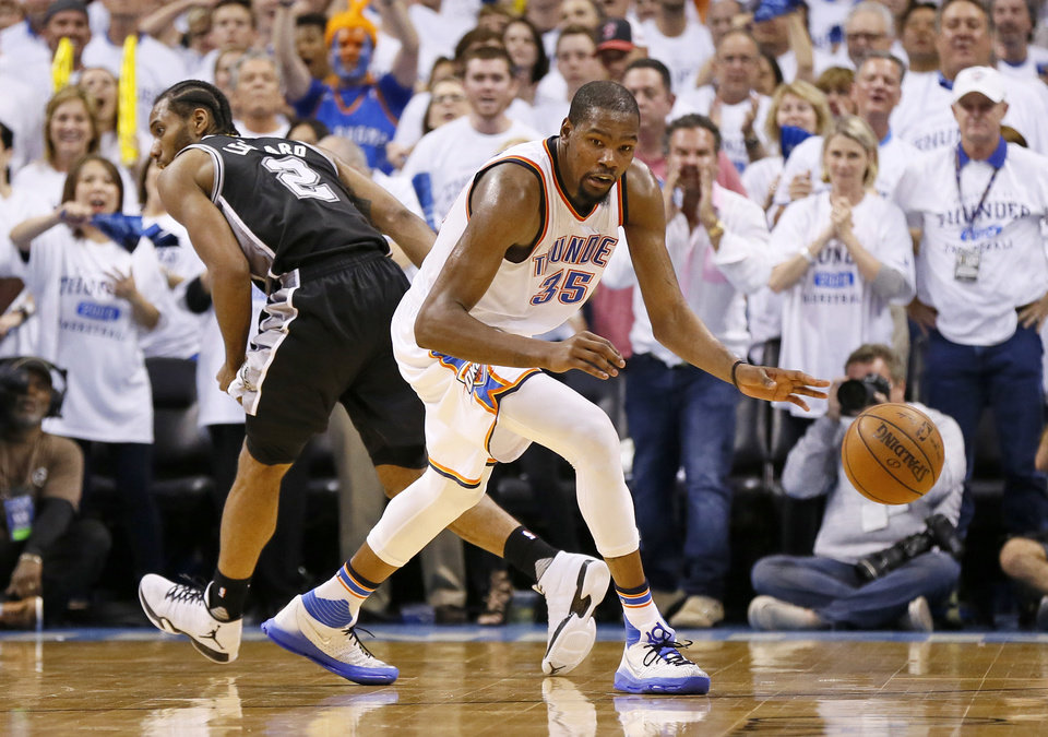 Photo - Oklahoma City's Kevin Durant (35) dribbles after stealing the ball from San Antonio's Kawhi Leonard (2) in the final minute of the fourth quarter during Game 4 of the Western Conference semifinals between the Oklahoma City Thunder and the San Antonio Spurs in the NBA playoffs at Chesapeake Energy Arena in Oklahoma City, Sunday, May 8, 2016. Oklahoma City won 111-97. Photo by Nate Billings, The Oklahoman