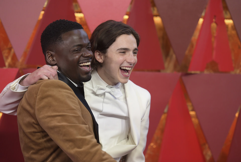 Photo - Daniel Kaluuya, left, and Timothée Chalamet arrive at the Oscars on Sunday, March 4, 2018, at the Dolby Theatre in Los Angeles. (Photo by Richard Shotwell/Invision/AP)